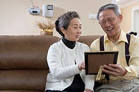 Senior couple looking at photo