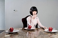 a business woman eating apple