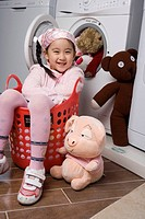 a girl sitting in the basket