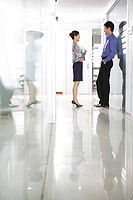 Young man and woman conversing