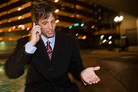 Businessman communicating on the mobile phone