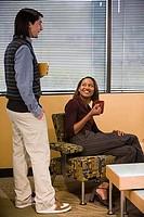 Man and woman holding mug and smiling