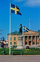 A building with swedish flags and statue
