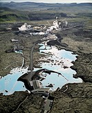 Iceland _ Aerial view of factory near lake and road