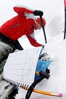 man checks the avalanche hazard on Hollyburn Mountain. Cypress Bowl, West Vancouver, British Columbia, Canada.