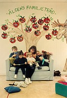 Woman and kids sitting on the couch