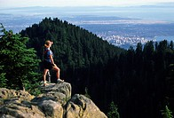 Women looking over Vancouver, from atop Goat Mountain Grouse Mountain, North Vancouver, British Columbia, Canada.