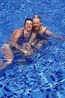 Mexico, Yucatan Peninsula, Carribean resort at Isla Mujeres, middle aged woman and senior mother in swimming pool