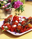 Peppers stuffed with tomatoes, feta and rosemary