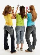 Three teens applying makeup