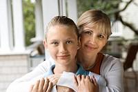 Caucasian mid_adult mother hugging pre_teen daughter.