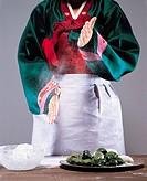 Woman In Korean Costume Making SongpyeonRice Cake,Korean Food