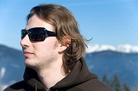 young man with sunglasses in the alps