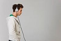 Side view of man wearing headphone