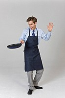 Man holding frying pan with funny
