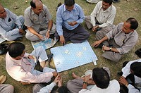 Delhi, India: men playing cards at the Lodi Garden