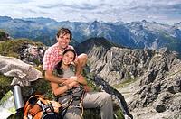 Austria, Salzburger Land, couple on mountain top, portrait