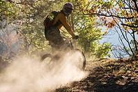 Italy, Southern Tyrol, man mountain biking