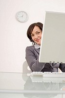 Businesswoman using a computer, portrait