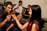 couple toasting each other at party