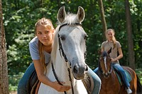 young woman on white horse