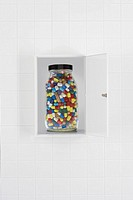 Jar of pills in bathroom cabinet