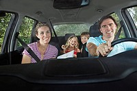 Family with two children 5_6 in car interior portrait