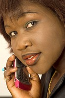 black african girl using cellular phone