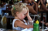 Netherlands Antilles, Curacao, a toddler girl trying to hide her tears