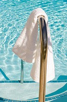 A towel next to a swimming pool