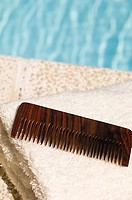 Comb on top of towels