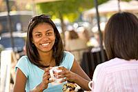 African teenaged girl holding coffee mug