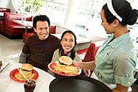 Asian couple being served at diner