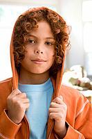 Mixed Race boy wearing hooded sweatshirt