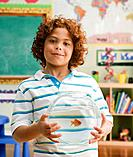 Mixed Race boy holding fish bowl