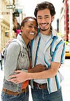 Multi_ethnic couple hugging