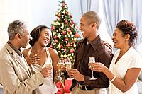 African family with adult children drinking champagne