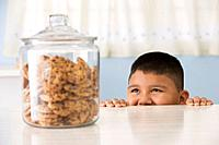 Hispanic boy looking at cookies