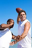 Multi_ethnic men playing football