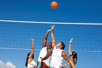Multi_ethnic friends playing volleyball