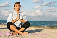 Hispanic man meditating