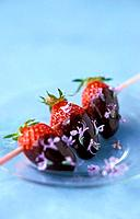 strawberry and chocolate skewer with rosemary