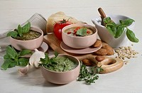 Still life: Herb sauces. Basil Genoese 'pesto' sauce, parsley, egg, anchovy green sauce 'salsa verde', basil and tomato Sicilian Trapani 'pesto' sauce