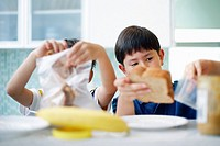 Little Boys Preparing Lunches