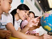 Woman Teaching Preschoolers about Geography