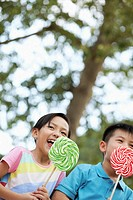 Boy and Girl Eating Lollipops