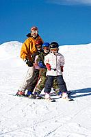 Mother skiing with children