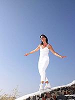 Woman walking on a low wall