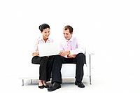 Man and woman smiling at laptop