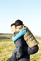 Man giving woman a piggyback